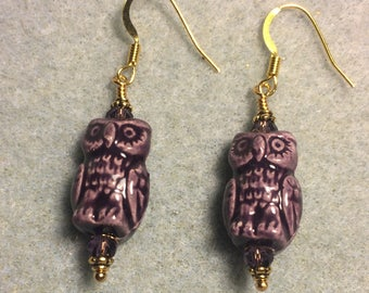 Purple ceramic owl bead earrings adorned with purple Chinese crystal beads.