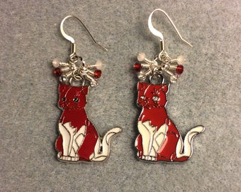 Red and white enamel cat charm earrings adorned with tiny dangling red and white Chinese crystal beads.