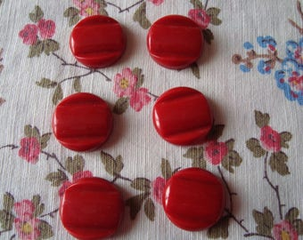 6 red plastic buttons