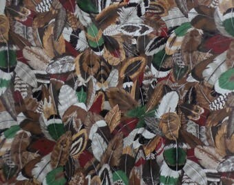 American Indian feathers bird cotton quilt fabric from VIP Cranston Print works 1 yard by 44 inches wide.