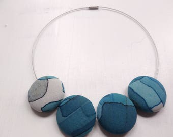 Blue necklace of covered with fabric buttons