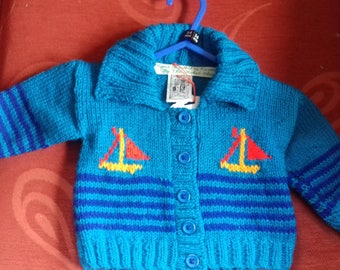 Hand knitted cardigan to fit a baby aged 3-6 months old