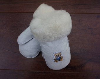 Children's leather gloves. Warm winter gloves. Woolen mittens for boy girls. Sheepskin mittens
