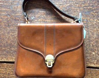 "Vintage handbag. 1970s Brown PVC Top Handle Bag with brass closure by Suzy Smith. 9"" x 7.5"" x 3"" strap 14"""