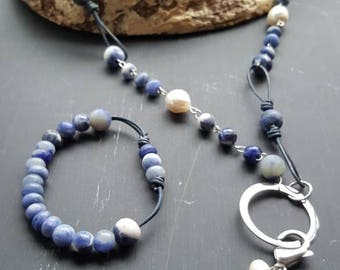 Denim and Steel are a timeless combination. Denim colored leather, Sodalite and stainless steel create a unique casual necklace set.