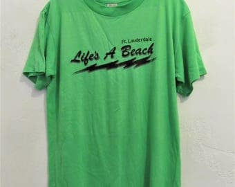 Cool Vintage 70's Soft Short Sleeve NE0N Green LIFE'S A BEACH,FL T shirt.M