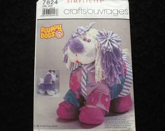 "Simplicity pattern 7824. Vintage uncut 1986 Walt Disney ""Fluppy Dog"". 12"" Cuddle Flup comes with dress and shoes."