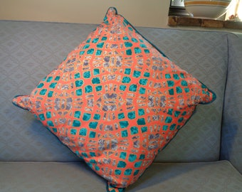 Orange and turquoise square cushion cover only. Bright and colourful with sparkle around the squares. Will enhance bedroom or living room.
