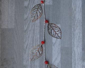 Silver and orange hair jewelry