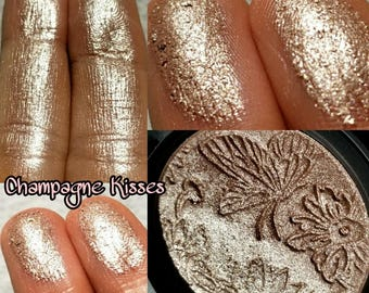 Champagne Kisses. Wet Extremely Metallic high shine highlighter. Beige Champagne with slight peach understone. Perfect for all skin tones.