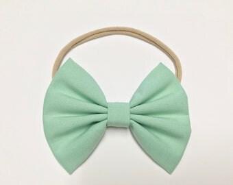 Baby/Girl Fabric Bow on Nylon Headband or Hair Clip