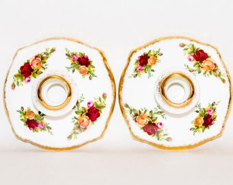 A pair of Royal Albert Old Country Roses Candle Holders