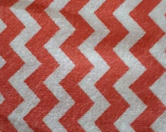 100% cotton fabric with orange Chevron