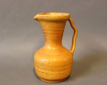 Small yellow ceramic jug