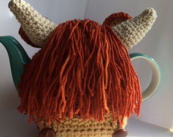 Handmade crochet Scottish Highland Cow or Coo Tea Cosy teapot cover made on the Isle of Skye