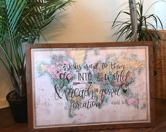 Large framed world map with custom quote