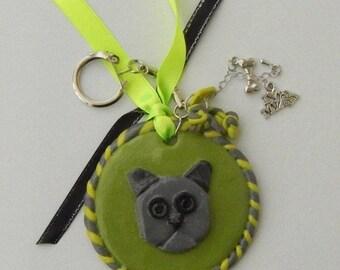 Key chain dog grey green polymer