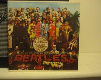 The Beatles-  Sgt. Pepper's Lonely Hearts Club Band, Capitol Records-  SMAS 2653