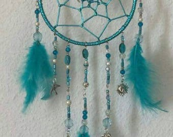 Gorgeous turquoise blue Dreamcatcher metallic beads, charms and feathers