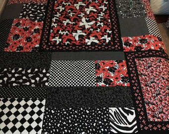 Black, white, red quilt