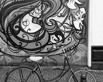 One of Amsterdams many bikes against a graffitti wall