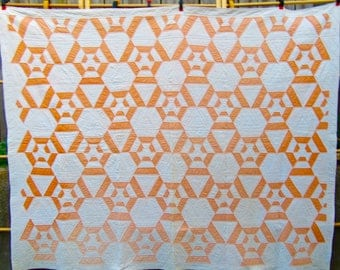 Spider Web Antique Quilt in Orange and White