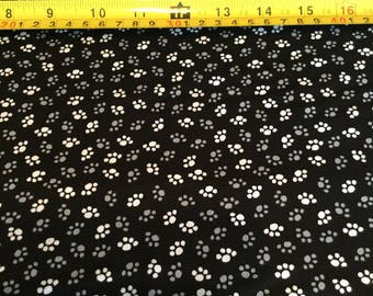 Wilmington Prints Paw Prints, black, white by the half yard
