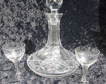 A nice flat bottomed cut glass decanter and pair of glasses.
