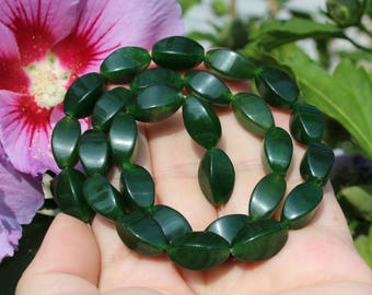2 16 X 9 MM AAA Emerald twist beads.
