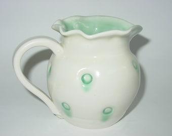 White ceramic pitcher