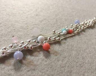 Coral bracelet, jade, chalcedony, quartz and silver