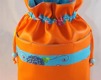 """Large pouch Kit toiletry bag in faux orange """"joyful"""" with three outside pockets"""