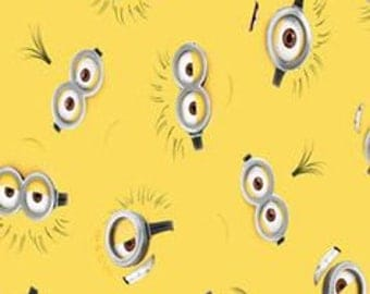 "Minion Eyes on yellow by VIP, 43-44"" wide, 100% cotton - by the half yard"