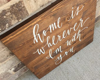 wooden sign -- home is wherever i'm with you.