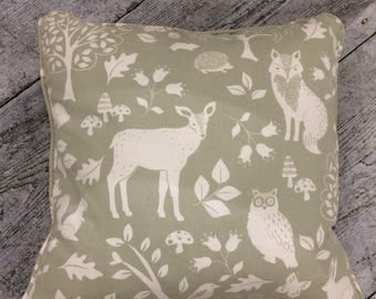 Feather filled green wildlife cotton fabric cushion,
