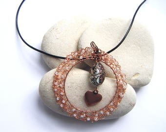 Crocheted with white pearls and copper wire pendant