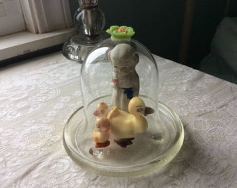 Sweet Vintage Shelf Display, Frozen Charlotte with Her Vintahe Wilton Cake Duck Family, under a Glass Flower Cab Cloche
