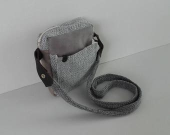 Money-bag man tissue and light gray leather.