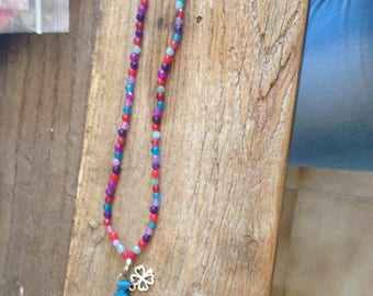 Long necklace Pearl semi precious multicolor color with a blue tassel and a clover.