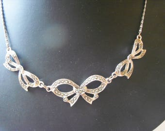 Sweet triple bow panel marcasite necklet on decorative chain