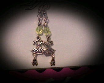 Ballerina earrings sliver charms w/yellow bead accents.
