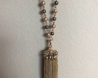 Long gold tassel necklace