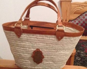 Traditional kept natural handmade goat leather and palm leaves