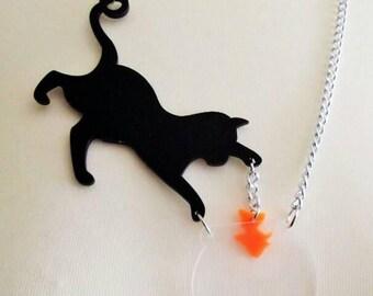 Acrylic cat and goldfish pendant necklace.