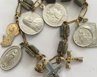 charming vintage bracelet with an assortment of medallions and crucifixes