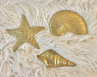 Vintage set of 3 solid brass coastal beach seashell wall hangings starfish conch and corithium