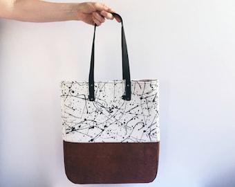 Cork bag, splatter design. Black and white. Brown cork fabric. Cork leather.