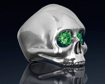 Sterling silver skull ring created emeralds, high quality handmade ladies rock n roll jewelry.  Our JANIS ring was inspired by Janis Joplin.
