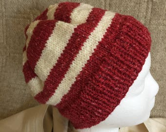 Red and white hat - strips to stand out in a crowd - find me on the sledding slope