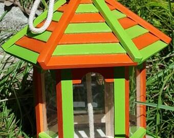 Orange and lime green bird feeder.